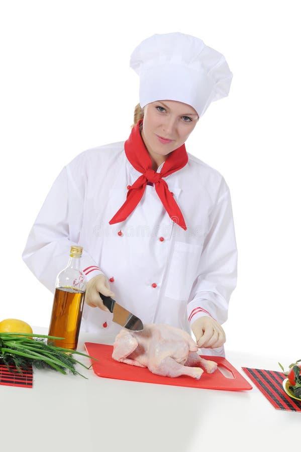 Cozinheiro chefe novo considerável no uniforme. imagens de stock royalty free
