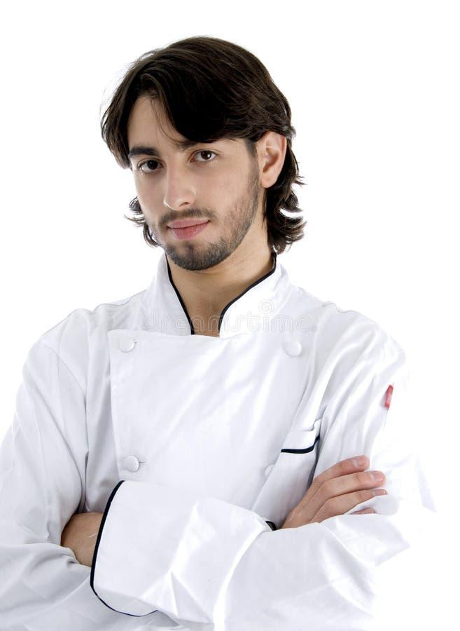 Cozinheiro chefe novo que levanta com seus braços cruzados imagem de stock royalty free