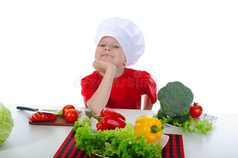 Cozinheiro chefe pequeno no uniforme. imagem de stock royalty free