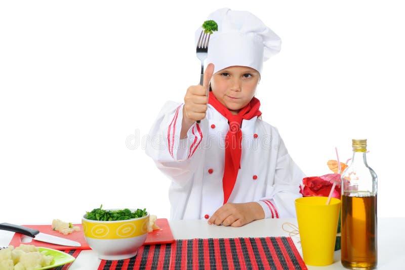 Cozinheiro chefe pequeno no uniforme. foto de stock