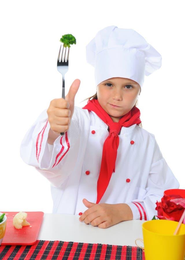 Cozinheiro chefe pequeno no uniforme. fotos de stock