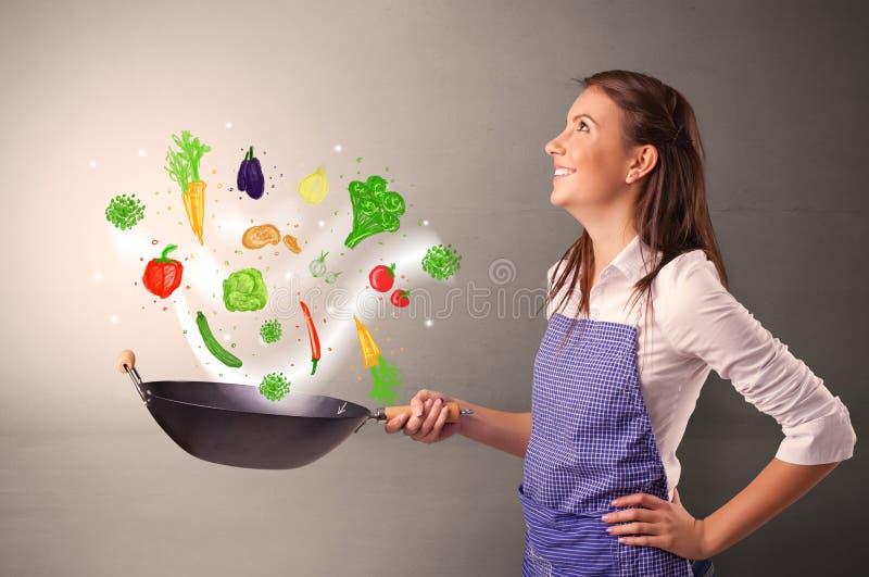 Cozinheiro com os vegetais tirados coloridos foto de stock