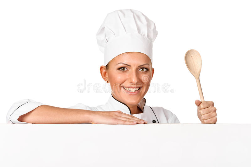 Cozinheiro, cozinheiro chefe ou padeiro guardarando a colher de madeira imagens de stock royalty free
