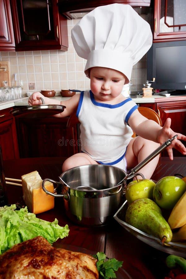 Cozinheiro da criança foto de stock