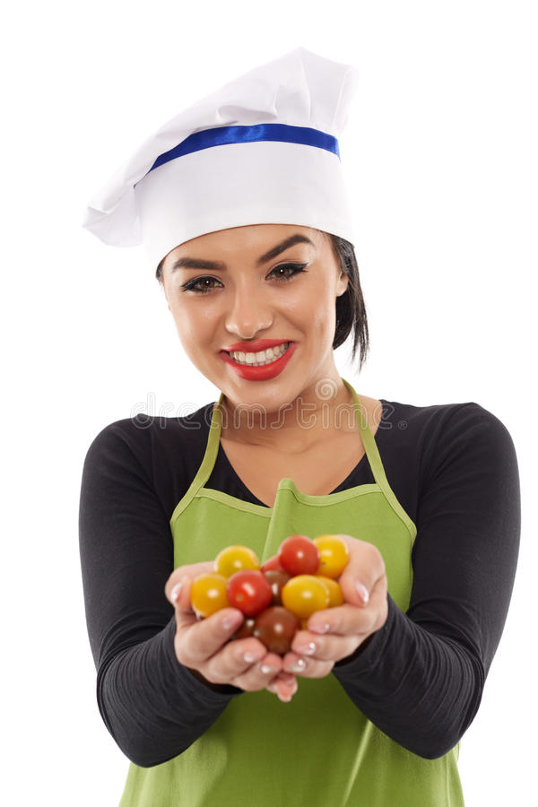 Cozinheiro da mulher com um grupo de tomates de cereja fotos de stock