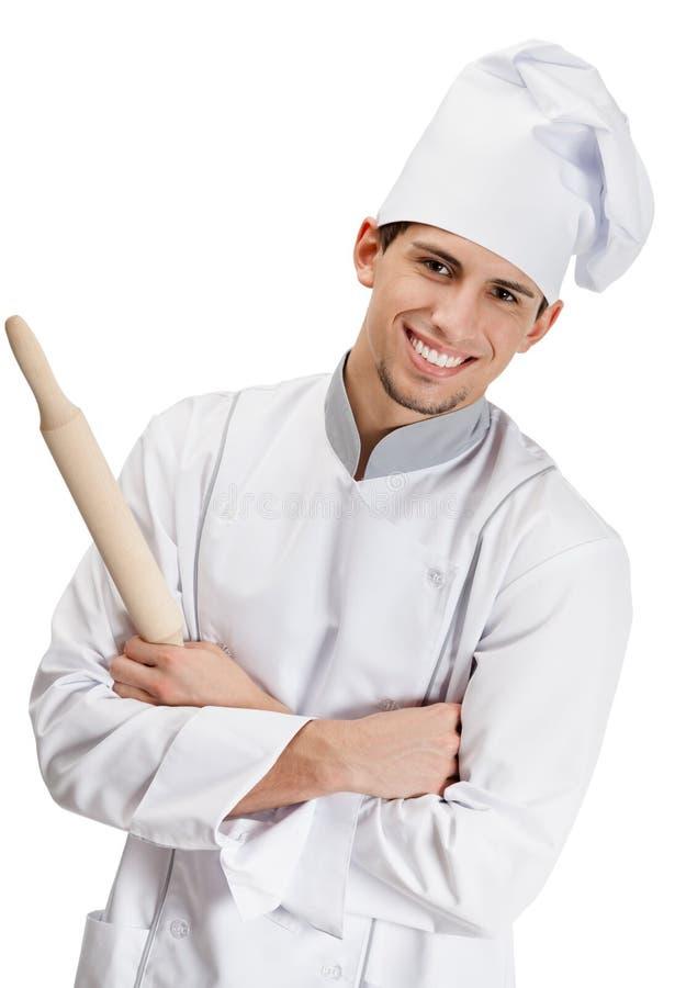 Cozinheiro do cozinheiro chefe com o pino do rolo de madeira imagens de stock royalty free