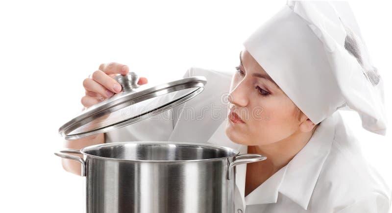 Cozinheiro do cozinheiro chefe da mulher com potenciômetro imagens de stock royalty free