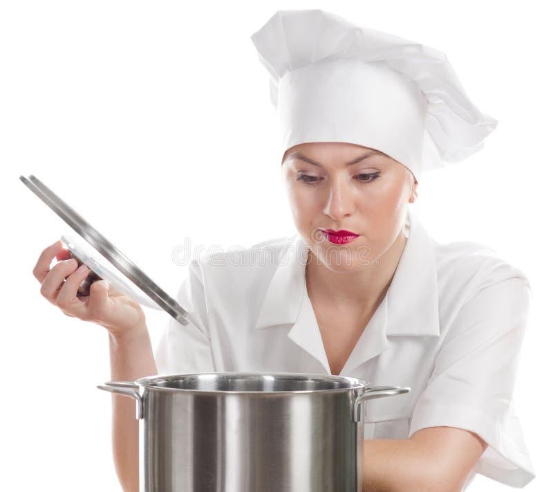 Cozinheiro do cozinheiro chefe da mulher com um potenciômetro imagem de stock royalty free