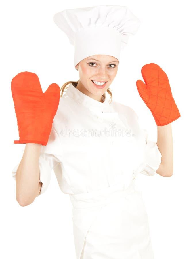 Cozinheiro fêmea com as luvas vermelhas da cozinha fotos de stock