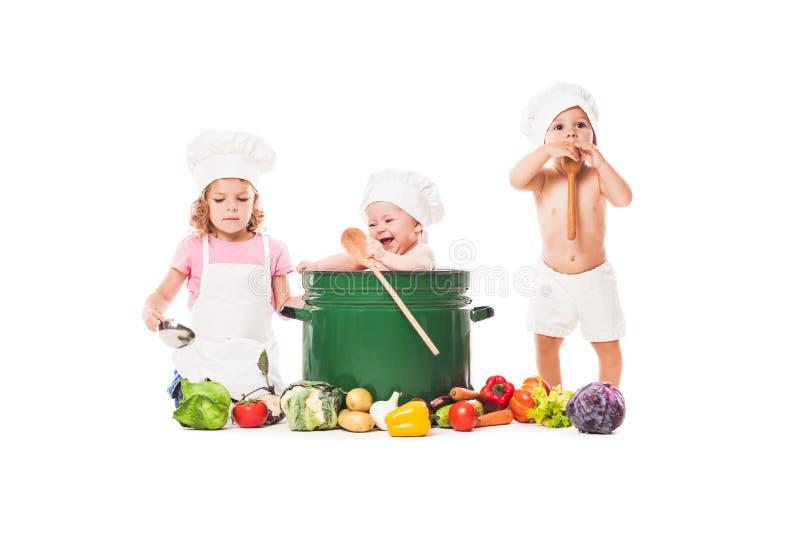 Cozinheiro pequeno dos cozinheiros chefe imagens de stock