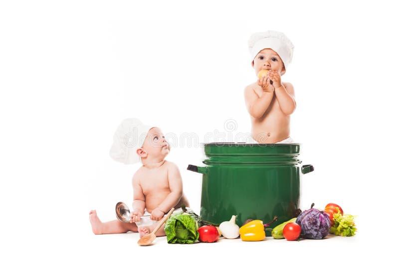 Cozinheiro pequeno dos cozinheiros chefe foto de stock royalty free