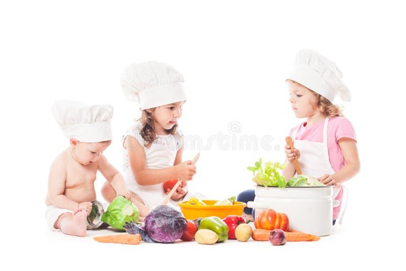 Cozinheiro pequeno dos cozinheiros chefe imagem de stock