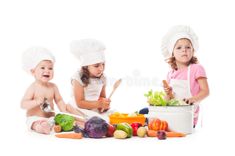 Cozinheiro pequeno dos cozinheiros chefe imagem de stock royalty free