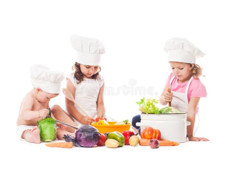 Cozinheiro pequeno dos cozinheiros chefe fotografia de stock