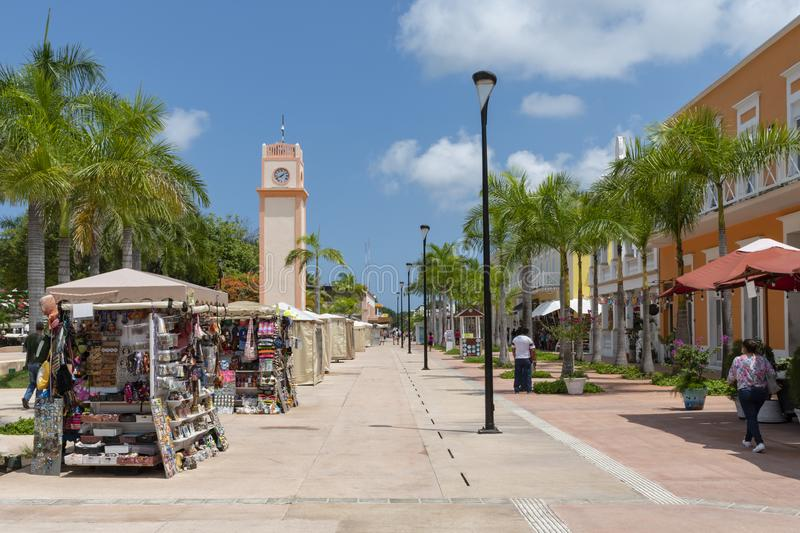 Cozumel main square with souvenir vendor booths, clock tower and. Colonial buildings royalty free stock images