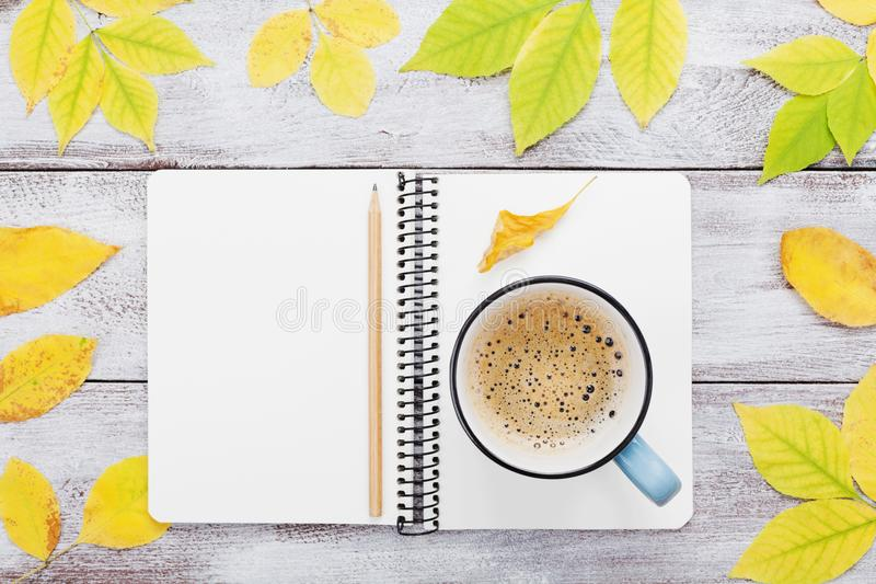Cozy autumn breakfast with morning cup of coffee and open notebook on rustic wooden table top view. Fall bucket list. Flat lay. Cozy autumn breakfast with stock photography