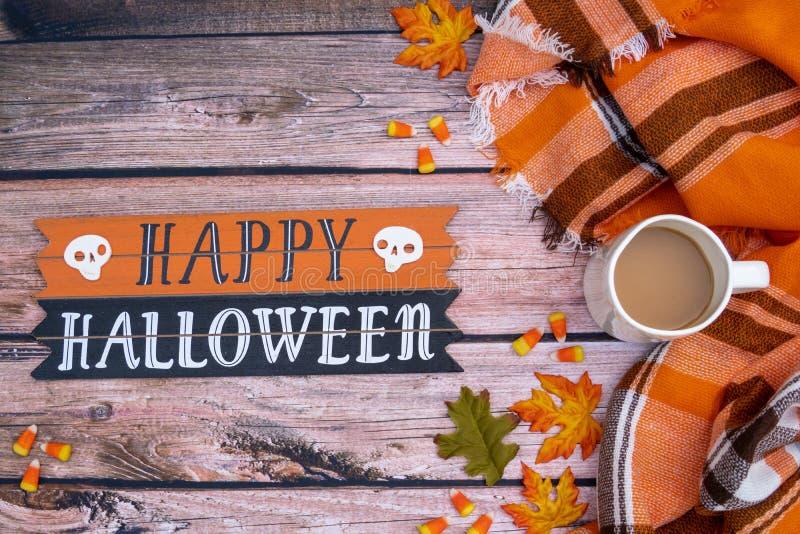 Cozy autumn coffee Happy Halloween flat lay background with orange plaid blanket royalty free stock image