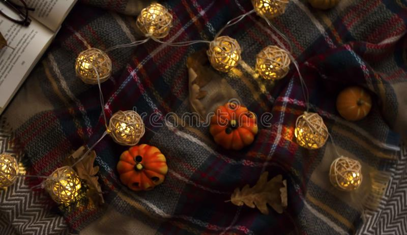Cozy autumn lights with small decorative pumpkins stock images