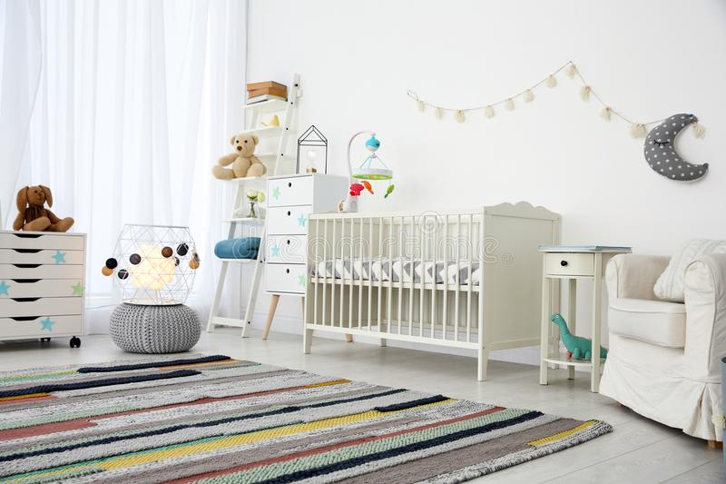 Cozy baby room interior stock images