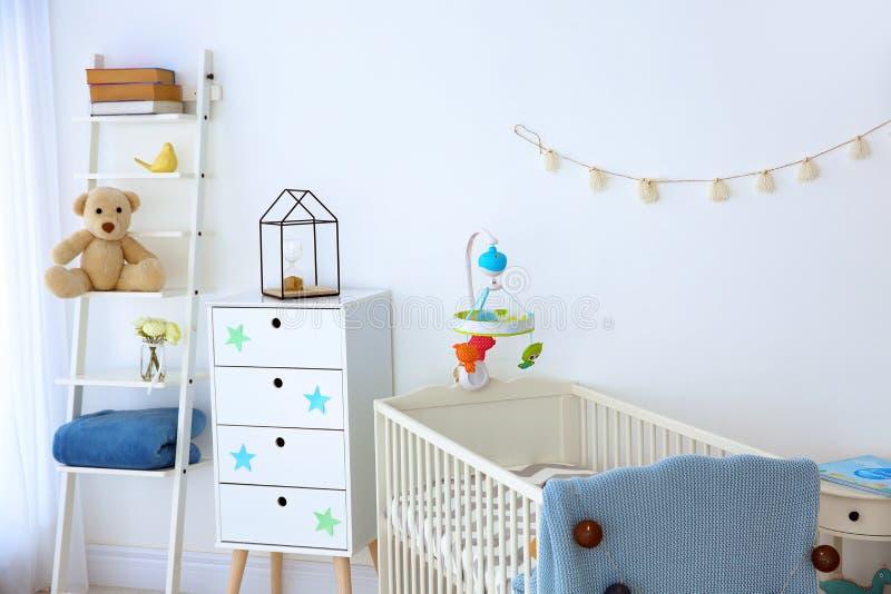 Cozy baby room interior royalty free stock image