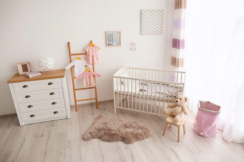 Cozy baby room interior stock photo