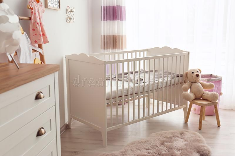 Cozy baby room interior stock photos