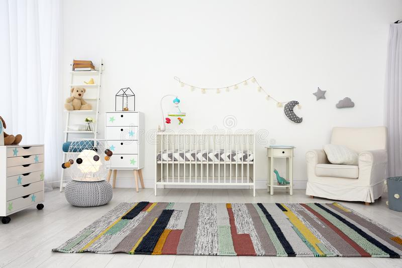 Cozy baby room interior with crib royalty free stock images