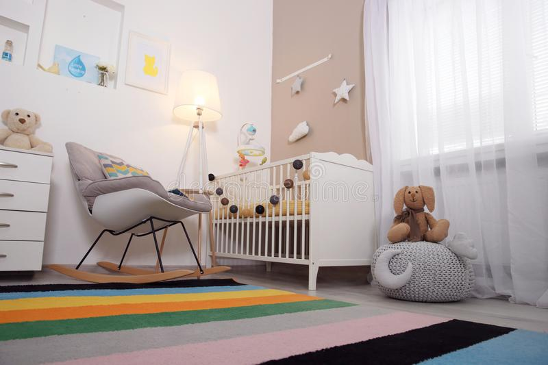 Cozy baby room interior with crib royalty free stock photography