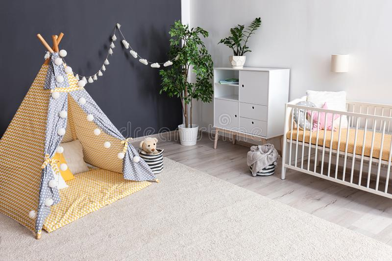 Cozy baby room interior with play tent stock images