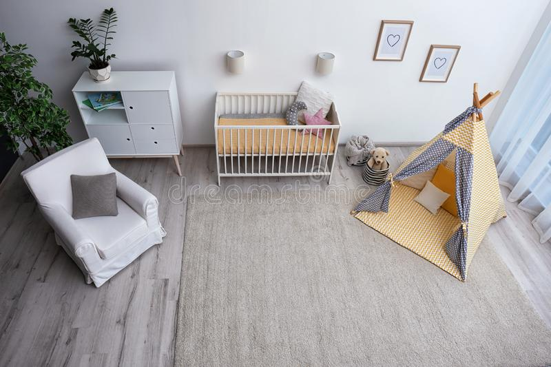 Cozy baby room interior with play tent and toys stock photography