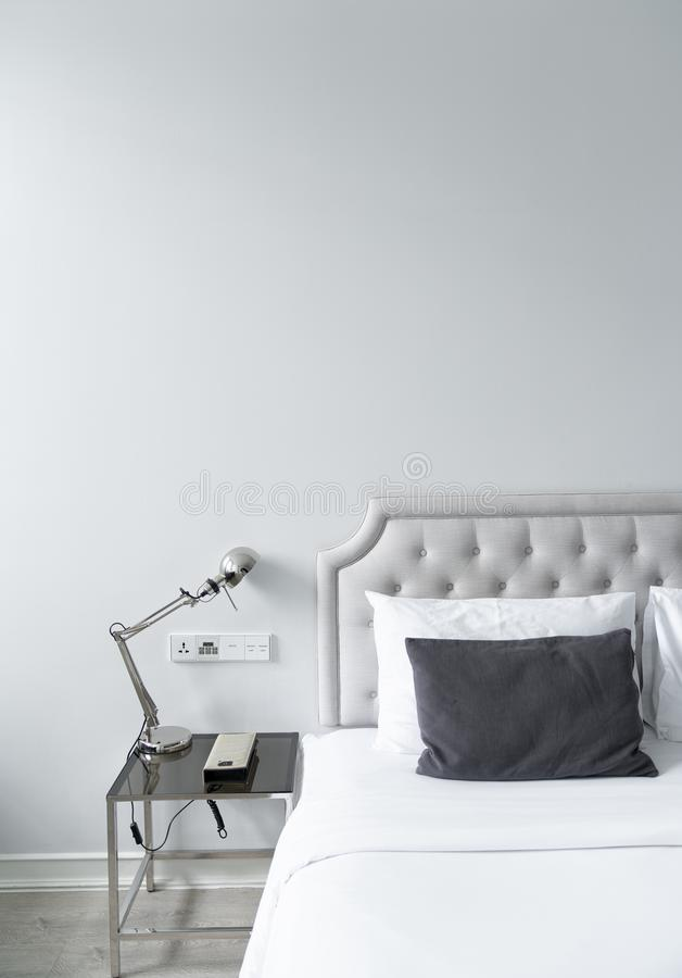 Cozy bedroom corner in minimal modern style with empty cool gray painted wall in the background / in terior concept / background f stock images