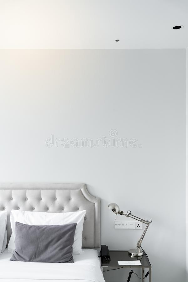 Cozy bedroom corner in minimal modern style with empty cool gray painted wall in the background / in terior concept / background f royalty free stock image