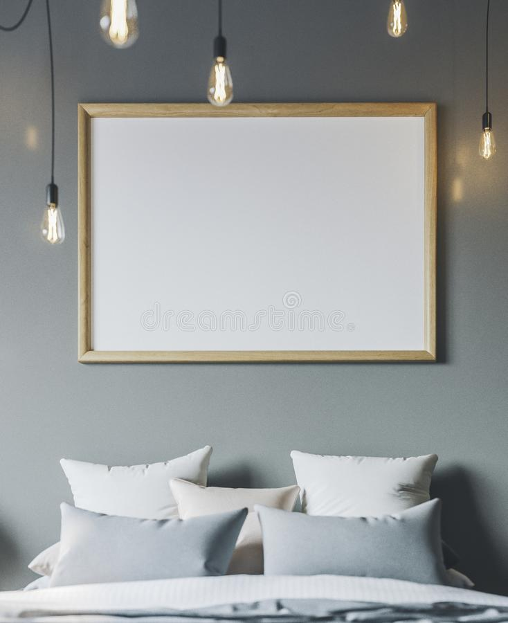 Cozy bedroom with empty poster frame. Frame mockup in interior. royalty free stock photos