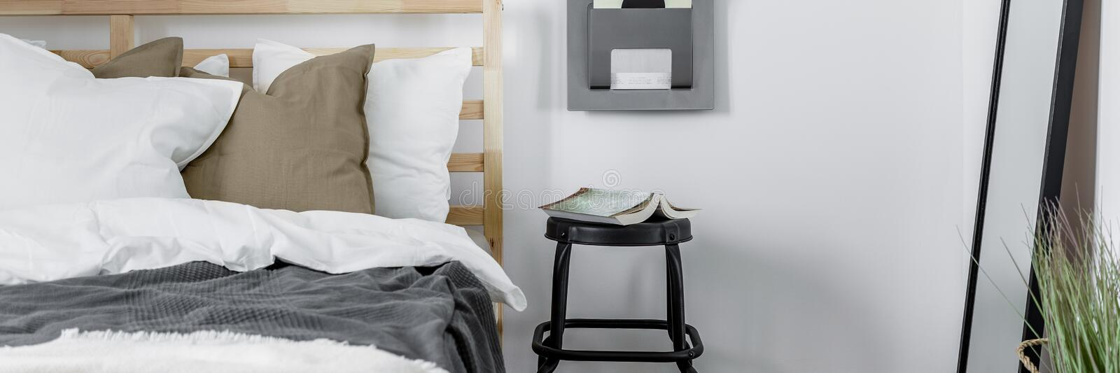 Cozy bedroom with wooden bed stock photos