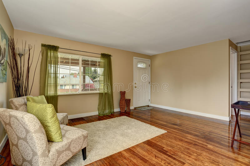 Cozy Beige Sitting Room With Shiny Hardwood Floor And Green Curtain ...