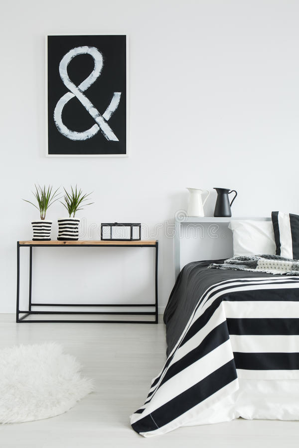 Cozy black and white bedroom royalty free stock image