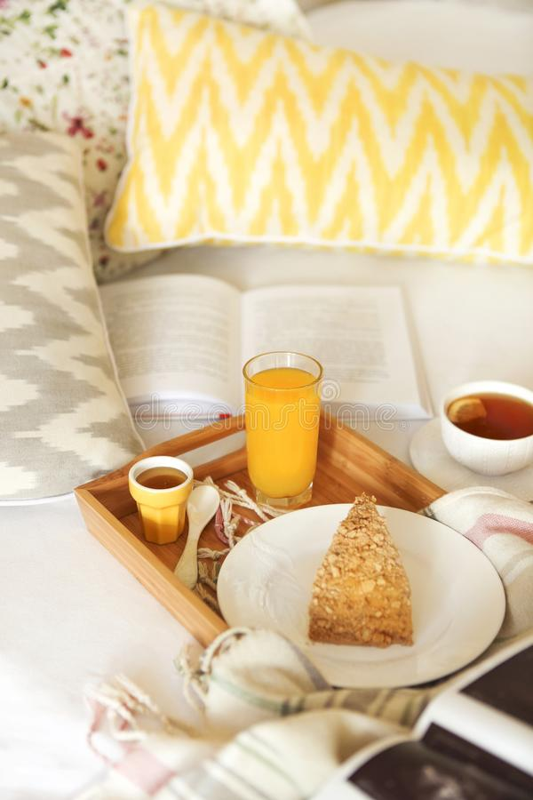 Cozy breakfast in bed with tea royalty free stock image