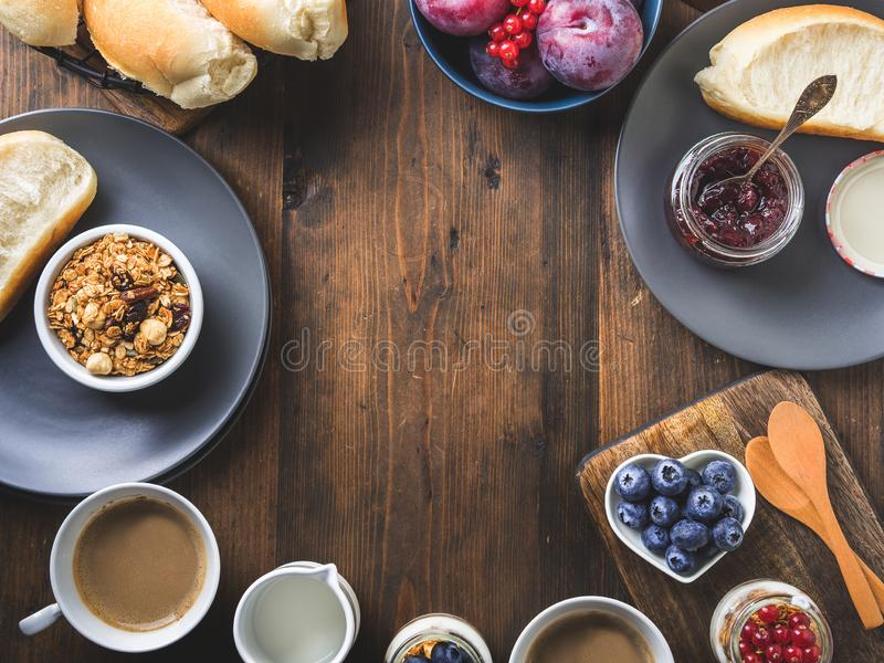 Cozy Breakfast food concept dark wooden background. Cozy Breakfast concept on dark wooden textured background. Food frame flat lay stock image