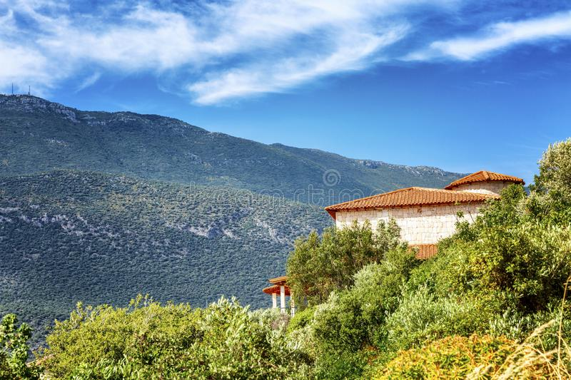 Cozy brick house in the mountains. Bright sunny day. Beautiful landscape stock images