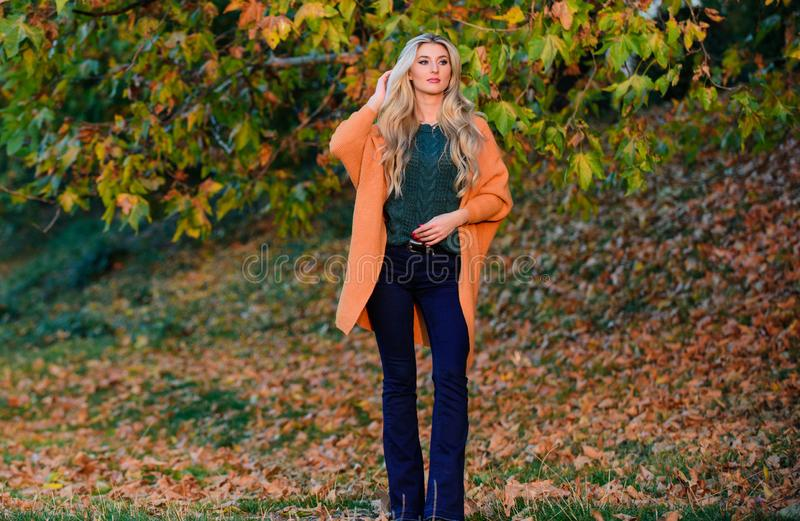 Cozy casual outfits for late fall. Comfortable outfit. Girl adorable blonde posing in warm and cozy outfit autumn nature. Background defocused. Cozy outfit stock images