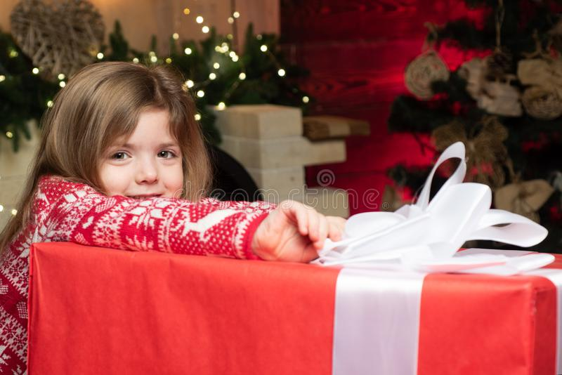 Cozy christmas atmosphere. Girl baby christmas eve. Merry christmas and happy new year. Cute little child girl play near royalty free stock photo