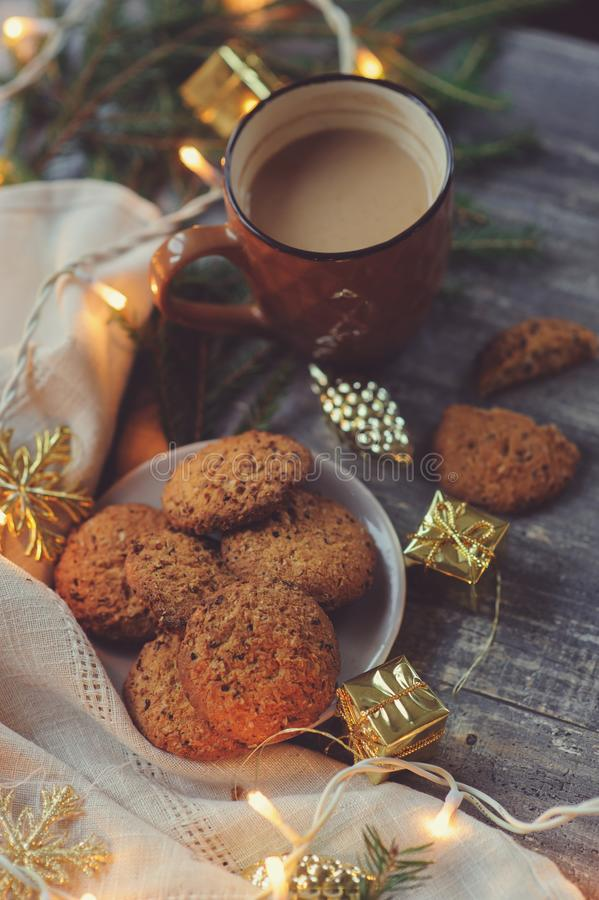 Cozy Christmas and winter setting with homemade cookies, coffee, lights and New Year decorations stock images