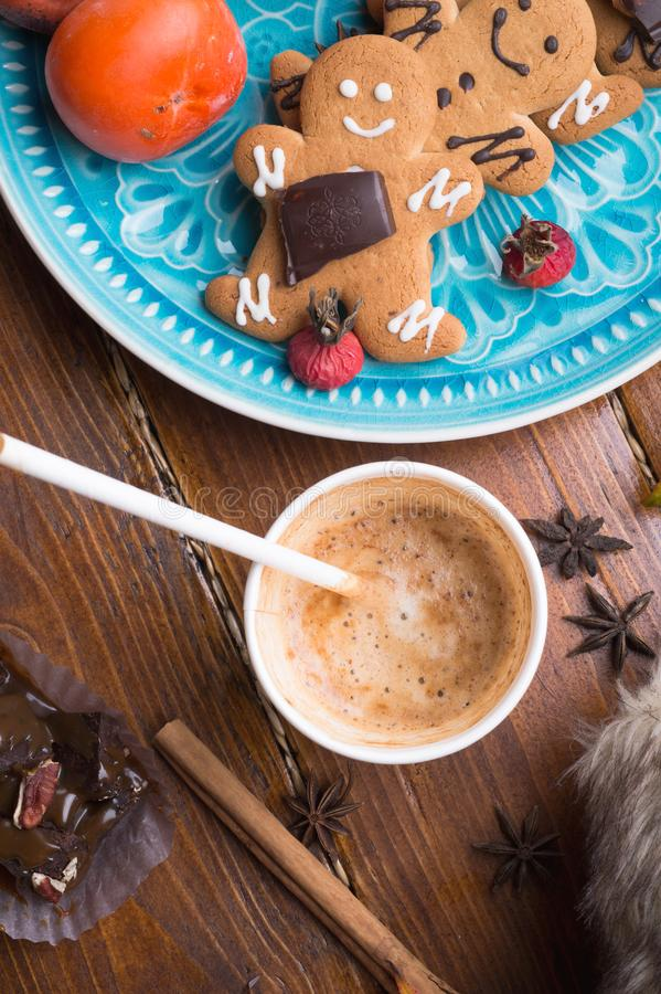 Cozy composition with coffe and  cookies at wooden table. life style concept. flat lay. close up. Cozy composition with coffe and  cookies at wooden table. life royalty free stock photo