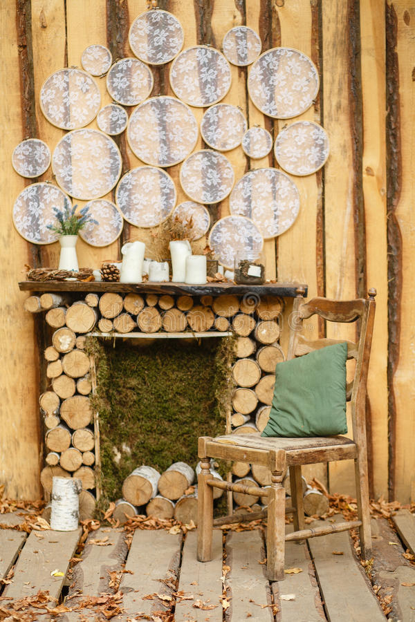Cozy corner in the garden by the fireplace. stock photography