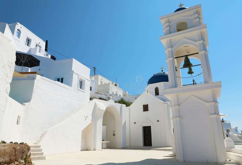 Cozy corner in Santorini with typical church in the village of Imerovigli, Greece stock photography