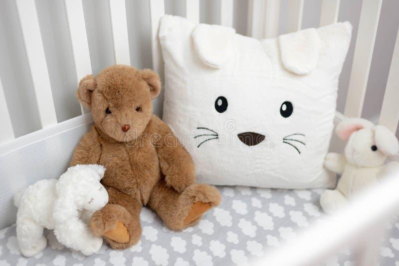 Cozy crib in gray and white neutral decor stock image