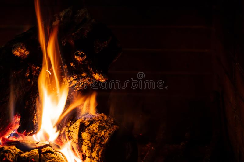 Cozy fireplace. Wood logs burning, relaxation and warm home royalty free stock images