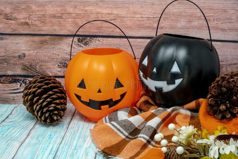 Cozy Halloween autumn concept background with pumpkin trick or treat buckets, plaid blanket. Cozy Halloween autumn concept background with pumpkin jackolantern royalty free stock photos