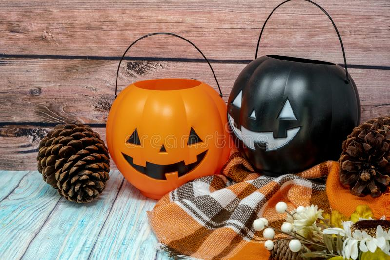 Cozy Halloween autumn concept background with pumpkin trick or treat pail buckets and pine cones. Cozy Halloween autumn concept background with pumpkin royalty free stock photography
