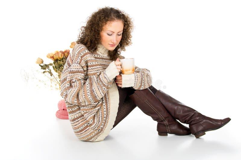 Cozy home girl with a mug